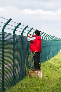 Marijke at the fence of Wittmund Air Base.