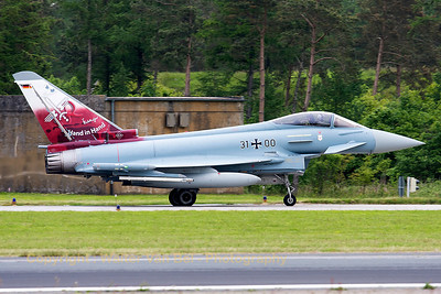"""German Air Force EF2000 (31+00; cnGS077), taxiing out for another QRA-mission. This aircraft carries a special c/s on its tail (on the left side: the special c/s to celebrate 55 years of JaboG31 (Fighter Bomber Wing 31) """"Boelcke"""",  on the right side """"Hand in Hand"""" refers to the close cooperation of JaboG31 and JG71 (Fighter Wing 71) """"R"""" in introducing the Eurofighter)."""