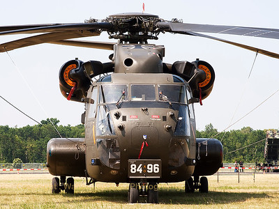 "Face to face with this German Army CH-53GA (84+96; cnV65-094) from HSG64, parked in the grass area next to the runway, during the spottersday prior to the ""Tag der Bundeswehr""."