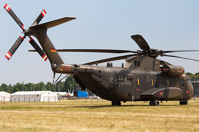 "German Army CH-53GA (84+96; cnV65-094) from HSG64, parked in the grass area next to the runway, during the spottersday prior to the ""Tag der Bundeswehr""."