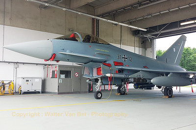 "This fully loaded German Air Force Eurofighter EF-2000 Typhoon S (31+12; cnGS088), could be seen in one of the hangars of Nörvenich, during the spottersday prior to the ""Tag der Bundeswehr""."