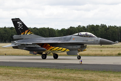 """Belgian Air Force F-16AM (FA-94; cn6H-94) from 31 """"Tigers""""-Sqn, is seen here on the taxitrack at Geilenkirchen AFB, showing the c/s for the 2017 NTM. Unfortunately, the special c/s stickers already showed some damage due to the extensive flying over the past weeks."""