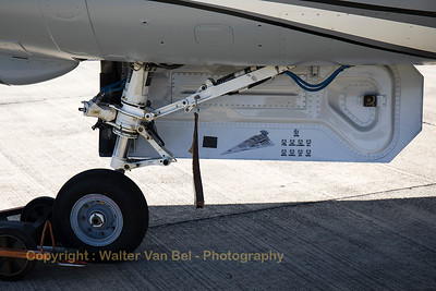 """Nose-wheel close-up of the """"Dark Falcon"""", showing some art-work of the crew. This F-16AM (FA-101; cn6H-101) will be the Belgian Air Force Solo Display Team for the next three years. Today, the new demo-jet was presented to the press and some lucky aviation enthousiasts!"""