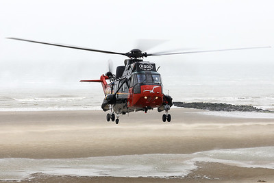 Belgian Air Force Sea King Mk48 (RS05, cnWA835), is seen here taking off from Wenduine Beach for the very last time...