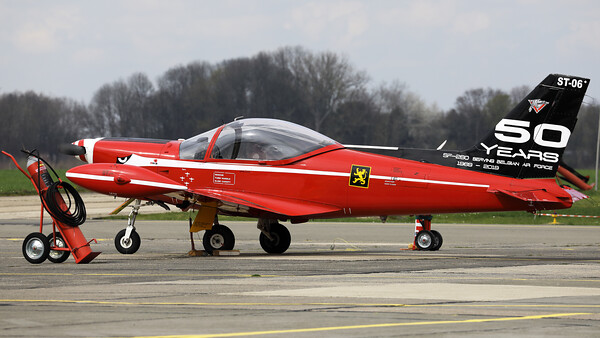 "This Belgian Air Force SF-260M+ Marchetti (ST-06+, msn10-06) - the ""Spare"" from the ""Red devils""-demo team - wears a special c/s on its tail to celebrate ""50 years of service in the Belgian Air Force""."