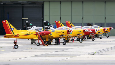 """View on part of the colourfull Beauvechain flightline. Closest to the camera is Belgian Air Force SF-260M+ Marchetti (ST-24+, msn10-24), followed by two wearing a special c/s on their tail to celebrate """"50 years of service in the Belgian Air Force""""."""