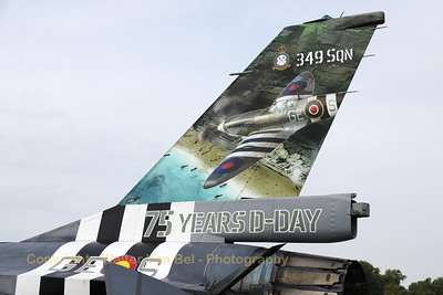 """Tail close-up of a Belgian Air Force F-16AM (FA-124; cn6H-124), with """"invasion stripes"""" as special c/s to celebrate """"75 years D-Day"""". 349 Squadron (and sister-squadron 350) found their origin during the second WW and their pilots participated during operation """"Overlord"""" in Normandy."""