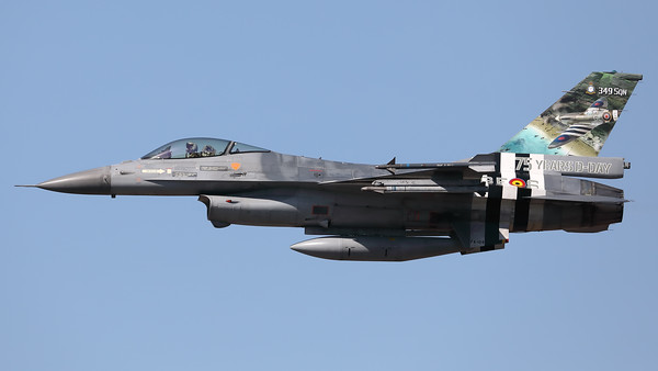"A Belgian Air Force F-16AM (FA-124; cn6H-124), with ""invasion stripes"" as special c/s to celebrate ""75 years D-Day"", is seen here during a high speed pass at Kleine Brogel AFB."