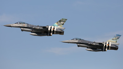 "The D-Day duo: Two Belgian Air Force F-16AM (FA-124; cn6H-124 from 349Sqn and FA-57; cn6H-57 from 350Sqn), with ""invasion stripes"" as special c/s to celebrate ""75 years D-Day"", seen here during a formation fly-by at Kleine Brogel AFB."