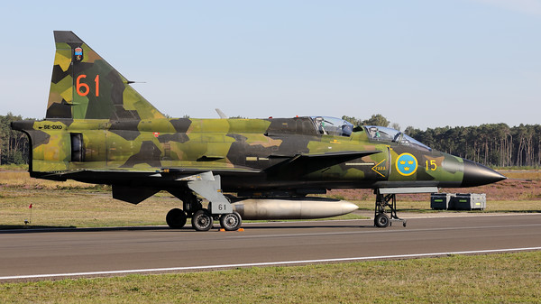 This Swedish Air Force Historic Flight SK37E Viggen (SE-DXO; cn37809; 15-61), wearing its beautiful camouflage c/s, is seen here parked on the taxiway at Kleine Brogel during the spottersday, prior to the Sanicole-Airshow.
