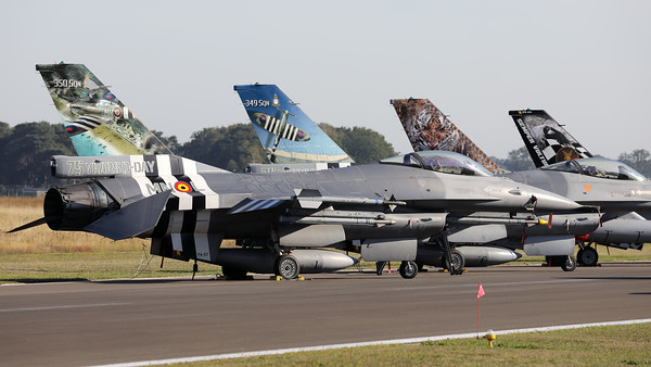"Gathering of special c/s F-16's at KB. Closest to the camera is F-16AM ""FA-57"" from 350Sqn, followed by F-16AM ""FA-124"" from 349Sqn, F-16AM ""FA-116"" from 31Sqn (Tigers) and F-16BM ""FB-24"" from OCU (10 Wing)."