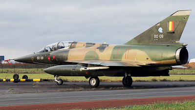 """Belgian Air Force Mirage 5BD (BD09; msn209), preserved in splendid condition at Brustem (St-Truiden). Here it can be seen being towed towards a no longer used taxiway, prior to the photoshoot, organized by the """"Mirage 5 BD09 Restoration Group""""."""