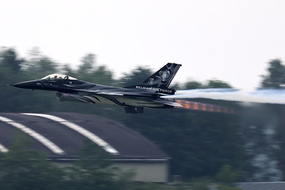 """The """"Dark Falcon"""" F-16AM (FA-101; cn6H-101), on take-off - producing some nice diamond shock-waves - during the BAF """"Anniversary Spottersday"""" at Florennes Air Base."""