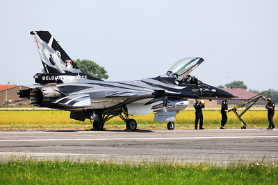 """The """"Dark Falcon"""" F-16AM (FA-101; cn6H-101) was also present for the special pop-up airshow at Koksijde Air Base. The groundcrew are preparing the jet for its display (note the wheel chocks are still on the main landing gear, while the jet is positioned at the beginning of Koksijde's runway11) and pilot Stefan """"Vador"""" Darte is going through his pre-flight checks."""