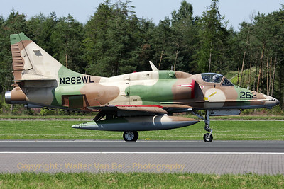 This colorfull A-4N Skyhawk from BAE Systems Flight Systems is slowing down on RWY08 - using its airbrakes and split-flaps - after another mission in support of JG71 at Wittmundhafen during the - very hot - spottersday for celebrating 50 years of Phantom II.