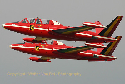 """Formation take-off of Fouga MT-37 and Fouga MT-26, showing their special markings - the former colors of the Belgian """"Red Devils"""" display team - during the spottersday/Nato Trainers Meet at Beauvechain. The pilot in the lead aircraft is TLP Commandant Mike Minne and his wingman is LTC """"Sergio"""" Mullerners."""