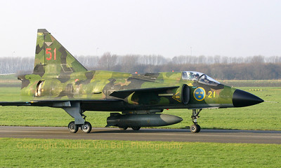 "Perfectly blending of the ""splinter""-camouflage of this Viggen with the Dutch landscape. The Viggen, piloted by Niklas Sandström, is taxiing towards its final resting place: The Aviodrome museum in Lelystad in The Netherlands."