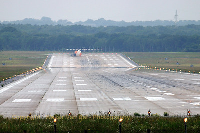 "Adverse weather during the arrivals for the celebration of ""25 Years NATO E-3A Component"" at Geilenkirchen AFB. A Polish Su-22 can be seen - with brake chute deployed - at the end of RWY27."