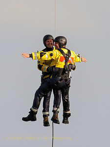 Nice rescue-demo during the Open Door at Melsbroek (EBMB), showing the two rescue-people in close-up while suspended from the winch of a MD900 Explorer (G-10, cn900-00034) from the Federal Police,