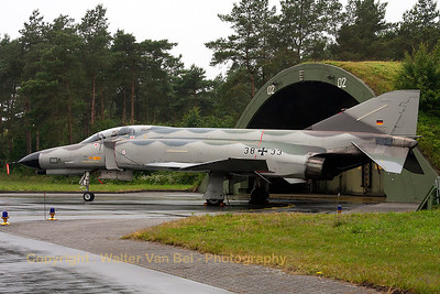 "The weather did not play ball during the spottersday, prior to the Phantom Pharewell at Wittmund Air Base. One of the last remaining F-4F Phantom II's - this one (38+33, cn4704) in ""Norm 81"" retro c/s - is seen here in front of its shelter."