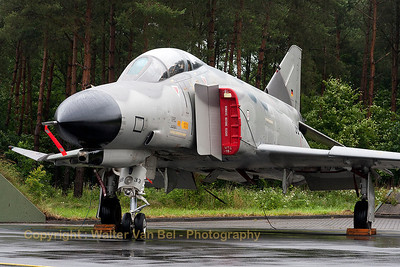 "The weather did not play ball during the spottersday, prior to the Phantom Pharewell at Wittmund Air Base. One of the last remaining F-4F Phantom II's - this one (38+33, cn4704) in ""Norm 81"" retro c/s - is seen here next to its shelter."