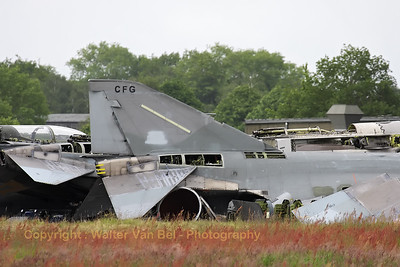 "The ""dump"" at Jever AB. Several hulls of German Air Force Phantoms and Tonados can be seen. Close-up of the tail of F-4F Phantom II identified as ""38+43"" (cn 4733; USAF serial number 72-1253). What a sad sight..."