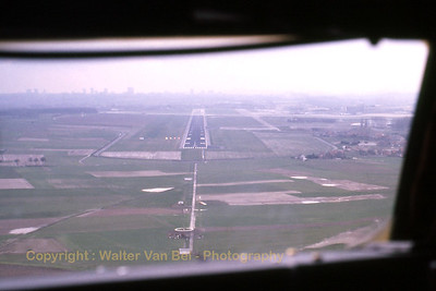 About to land in Brussels on RWY25L, on a hazy afternoon. Return flight from Alicante, jump-seat ride on board of TEA's Boeing 707-328B (reg.OO-TYC). Scan from slide.