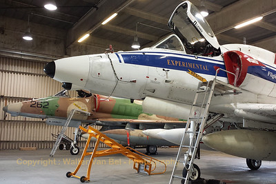 This A-4N Skyhawk from BAE Systems Flight Sytems (N437FS; cn 14504) is seen in the hangar at Wittmund Air Base. It is already equipped with extra ferry tanks for the flight towards the USA. [Samsung S4]