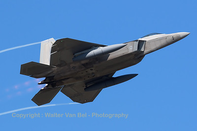 This USAF F-22A Raptor (05-4097; TY; cn645-4097) departs Spangdahlem Air Base - equipped with ferry-tanks for crossing the Atlantic - with full AB and vortices streaming from the wing-tips. What an unforgettable sight this was!!