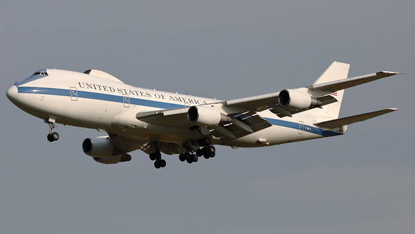 """The USAF Advanced Airborne Command Post """"Nightwatch"""" - nicknamed """"Doomsday Plane"""", a Boeing E-4B (747-200B) (73-1676; msn20682) on final for RWY01 at Brussels Airport.  The E-4B serves as a survivable mobile command post for the National Command Authority, namely the President of the United States, the Secretary of Defense, and successors. The four E-4Bs are operated by the 1st Airborne Command and Control Squadron of the 595th Command and Control Group located at Offutt Air Force Base, near Omaha, Nebraska. An E-4B when in action is denoted a """"National Airborne Operations Center""""."""