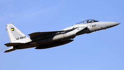 A JASDF F-15J (42-8947; cn147) from 306 Hikotai (Golden Eagle), seen here en route for another training mission, after take-off from Hyakuri's RWY03R.