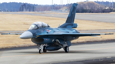 A JASDF Mitsubishi F-2B (03-8104; cn3004) from 21 Hikotai, on the taxi-track at Hyakuri Air Base. The 21st Fighter Training Squadron is a squadron of the 4th Air Wing of Air Training Command of the Japan Air Self-Defense Force. It is based at Matsushima Air Base in Miyagi Prefecture, Japan.