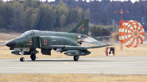 "JASDF RF-4EJ (77-6392; cnM092) from 501 Hikotai - in the splendid ""Grey-Green c/s"" - seen here recovering to Hyakuri, while slowing down with the use of its brake-chute, after completing another recce-mission. The 501st Tactical Reconnaissance Squadron is a squadron of the Japan Air Self-Defense Force based at Hyakuri Air Base (Ibaraki Airport) in Ibaraki Prefecture, Japan."