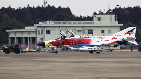 The special c/s JASDF F-4EJ-KAI (07-8428; cnM128) from 302 Hikotai (White-tailed Eagle), is seen here being towed across the apron at Hyakuri. The 302nd Tactical Fighter Squadron is a squadron of the 7th Air Wing of the Japan Air Self-Defense Force (JASDF) based at Hyakuri Air Base (Ibaraki Airport) in Ibaraki Prefecture, Japan.