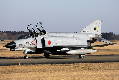 "JASDF F-4EJ-KAI (57-8356; cnM056) from 301 Hikotai (Frogs), on the taxiway at Hyakuri. The squadron emblem of the 301st Squadron is a frog wearing a scarf. The word for ""frog"" in Japanese is kaeru, the same sound (but different characters) as the word for ""come home"" (safely). The frog is based on the Japanese common toad, which is found by Mount Tsukuba nearby Hyakuri airbase where the squadron was formed."