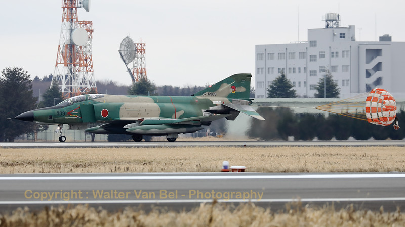 "JASDF RF-4E (57-6909; cn4616) from 501 Hikotai, - in the splendid ""Tan-Green c/s"" - seen here recovering to Hyakuri, while slowing down with the use of its brake-chute, after completing another recce-mission. The 501st Tactical Reconnaissance Squadron is a squadron of the Japan Air Self-Defense Force based at Hyakuri Air Base (Ibaraki Airport) in Ibaraki Prefecture, Japan."
