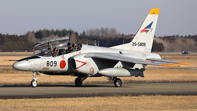 A JASDF Kawasaki T-4 (26-5809; cn1209), from 302 Hikotai (White-tailed Eagle), on the taxiway at Hyakuri. The 302nd Tactical Fighter Squadron is a squadron of the 7th Air Wing of the Japan Air Self-Defense Force (JASDF) based at Hyakuri Air Base (Ibaraki Airport) in Ibaraki Prefecture, Japan. It is equipped with McDonnell Douglas F-4EJ Kai Phantom II and Kawasaki T-4 aircraft.