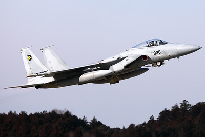A JASDF F-15J (22-8936; cn136) from 306 Hikotai (Golden Eagle), seen here on take-off from Hyakuri's RWY03R, while tucking in the landing-gear.