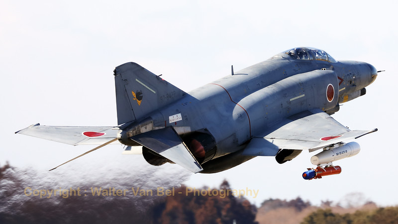 A JASDF F-4EJ-KAI (97-8422; cnM122) from 301 Hikotai (Frogs), on take-off at Hyakuri, at the start of another training session. The Phantom is carrying an AGST-36 Aerial Gunnery Target System (RMK-35/A37U-36) under its starboard wing.