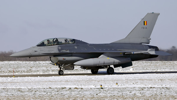 One of the local jets, a Belgian Air Force F-16BM (FB-14; cn6J-14), seen here  on the taxitrack at Florennes Air Base, after landing on RWY08L, during a very cold winter day.