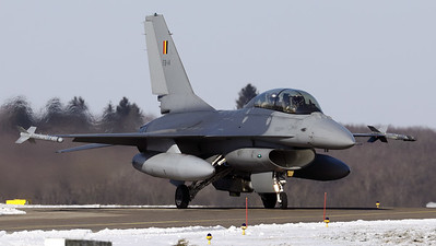 One of the local jets, a Belgian Air Force F-16BM (FB-14; cn6J-14), seen here after landing on RWY08L and turning onto the taxitrack at Florennes Air Base, during a very cold winter day.