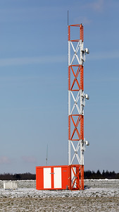 A bird of prey is taking a rest on the ILS-antenne-structure...