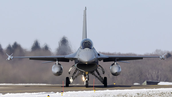 Head-on view on one of the local jets, a Belgian Air Force F-16BM (FB-14; cn6J-14), seen here after landing on RWY08L and turning onto the taxitrack at Florennes Air Base, during a very cold winter day.