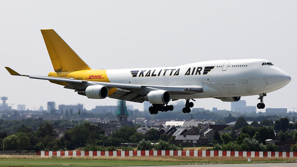 This Boeing 747-446 (BCF) (N743CK; msn26350) from Kalitta Air (DHL), is seen here on final for RWY01 at Brussels Airport. Note the piano keys reflected on her nose!