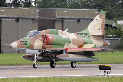 This colorfull A-4N Skyhawk from BAE Systems Flight Systems is slowing down on RWY26 - using its airbrakes and split-flaps - after another mission in support of JG71 at Wittmundhafen.