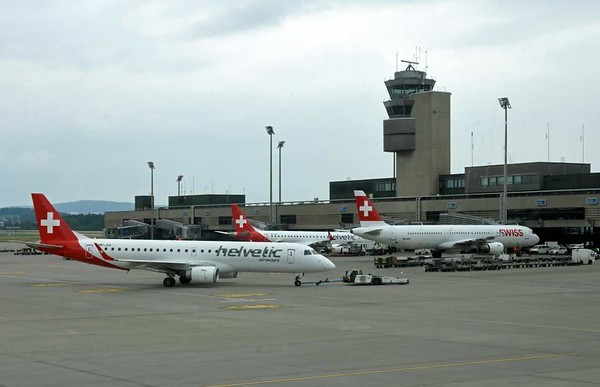Helvetic Airways Embraer ERJ-190 HB-JVO, Zurich, Tues 16 June 2015 - 1544.  Behind are Helvetic Fokker F100 HB-JVD (left) and Swiss Airbus A321-200 HB-ION.