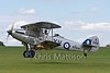 The superb and beautifully restored Hawker Hind (Afgan) reg G-AENP, built 1935, gets off the ground.