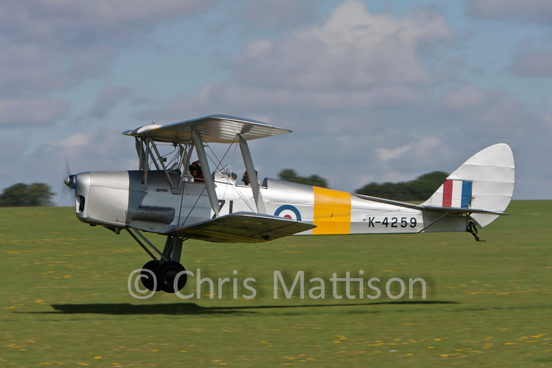 De Havilland DH82a Tiger Moth, reg G-ANMO, lifting off.