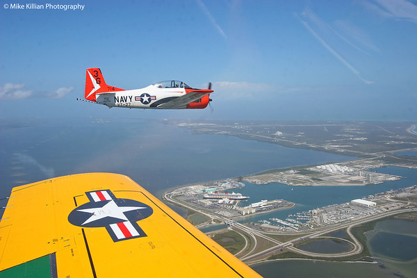 In formation over Port Canaveral, Disney's cruise ship Fantasy and Cape Canaveral Air Force Station both clearly visible below.