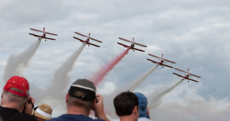 Hello boys!  Duxford, 13 July 2008.   The AeroSuperBatic team's Boeing Stearmans arrive.  In 2008 they were sponsored by Guinot skincare products, a surprising bit of marketing given the typical air show audience....   Previous sponsors had been Utterly Butterly and before that Crunchie choc bars.  Since 2010 the sponsor has been Breitling watches.